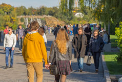 Young loving couple walking together on a Dnepr river embankment in center of the Dnepr city. DNEPR, UKRAINE - OCTOBER 02, 2016:Young loving couple walking royalty free stock photos