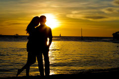 Young loving couple on wedding day on tropical beach and sunset. Sea background Stock Image