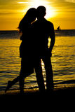 Young loving couple on wedding day on tropical beach and sunset Royalty Free Stock Photography