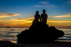 Young loving couple on wedding day on tropical beach and sunset Stock Photography