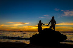 Young loving couple on wedding day on tropical beach and sunset Stock Photo