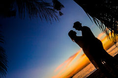 Young loving couple on wedding day on tropical beach and sunset Royalty Free Stock Image