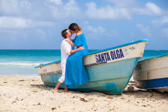 Young loving couple wedding near the boat.  Royalty Free Stock Images
