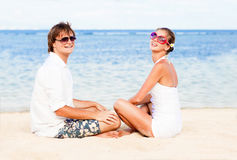Young loving couple in white on tropical beach. Royalty Free Stock Photography