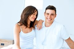 Young happy couple in the bedroom stock photo