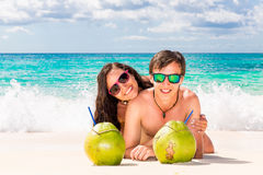 Young loving happy couple have fun on tropical beach, with cocon. Uts. Summer vacation concept Stock Photo