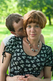 Young loving kissing couple teens stock images