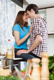 Young loving man and girl having flirt at domestic kitchen Stock Photo