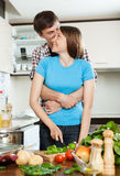 Young loving man and girl having flirt at domestic kitchen Royalty Free Stock Photography