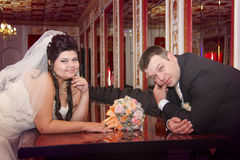 Young loving newlyweds posing Royalty Free Stock Images