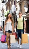 Young loving pair with shopping bags at city Stock Photo