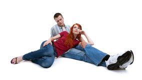 Young loving people on the floor Royalty Free Stock Photo