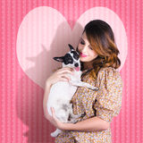 Young Loving Woman Holding Cute Small Pet Dog Royalty Free Stock Photo