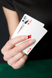 Young lucky gambler with cards Stock Image