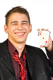 Young lucky gambler with cards Stock Photography