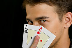Young lucky gambler with cards Royalty Free Stock Image