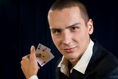 Young lucky gambler with cards Royalty Free Stock Photography