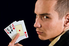 Young lucky gambler with cards. In hand Royalty Free Stock Photos