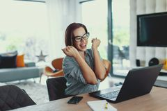 Young lucky succeessful freelancer woman in happiness at laptop stock photos
