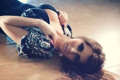 Young lying woman portrait Royalty Free Stock Images