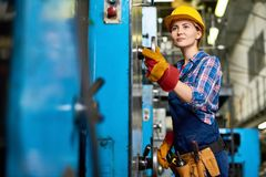 Free Young Machine Operator Concentrated On Work Stock Photography - 100068782
