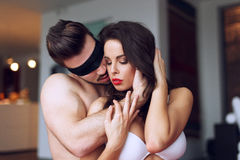 Young macho playing with sexy woman Royalty Free Stock Images