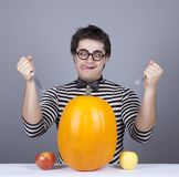 The young mad men try to eat apples and pumpkin. Stock Photography