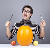 The young mad men try to eat apples and pumpkin. Stock Photo