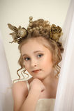 Young magic fairy with gold flowers Stock Photo