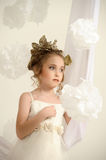 Young magic fairy with gold flowers Royalty Free Stock Image