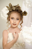 Young magic fairy with gold flowers Royalty Free Stock Photos