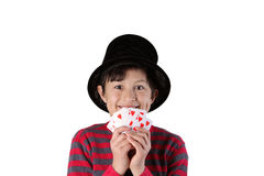 Young magician boy with cards Royalty Free Stock Images