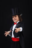 Young magician boy using his magic wand Stock Photography