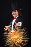 Young magician boy using his magic wand Stock Photos