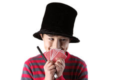 Young magician boy with wand Stock Photos