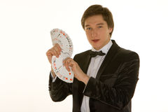 Young magician with cards Stock Images