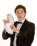 Young magician with cards Stock Image