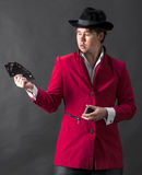 Young magician in hat with cards Royalty Free Stock Photo