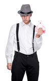 Young magician  holding playing cards Royalty Free Stock Photos