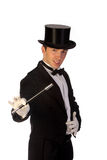 Young magician performing with wand Stock Photo