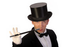 Young magician performing with wand Stock Photography