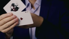 Young magician show a trick with cards stock video