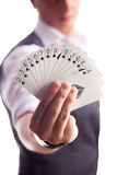 Young magician showing tricks using cards from deck. Close up. Stock Images
