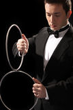 Young magician with silver metal rings Royalty Free Stock Photos