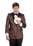 Young magician  in suit holding playing cards Royalty Free Stock Image