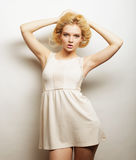 Young magnificent woman in white dress. Royalty Free Stock Image