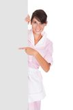 Young Maid With Bill Board Royalty Free Stock Photography