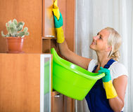 Young maid cleaning at apartment Royalty Free Stock Images