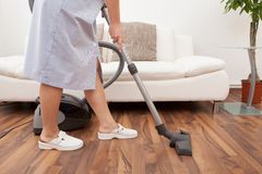 Young maid cleaning floor Royalty Free Stock Photo