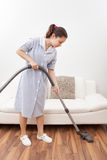 Young maid cleaning floor Stock Photography